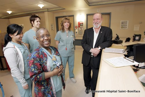 """ST. BONIFACE HOSPITAL - """"Future of Health Care in MB""""Dr. Michel Tetreault, President and CEO, St. Boniface General Hospital, poses with staff in the LDRP on Thursday, March 28, 2007. (Photo by Marianne Helm)"""